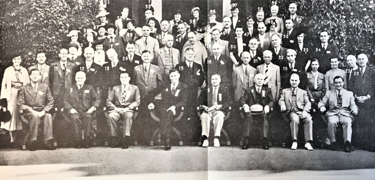 The photograph in the banner for this page depicts the men and women attending the 1938 International Conference on Correspondence Education